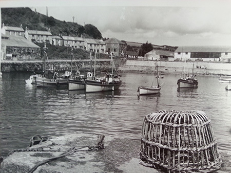 The harbour with the fish curing stores in the background