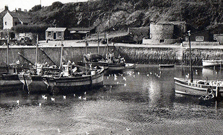 An early view across the harbour with the Lime Kiln in the background.