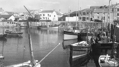 The harbour in the 1940's. The Account House is the building with the large wooden door behind boat PZ165.