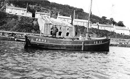 William Miners on his boat The Celie in the 1930's. The China Clay Store can be seen in the background.